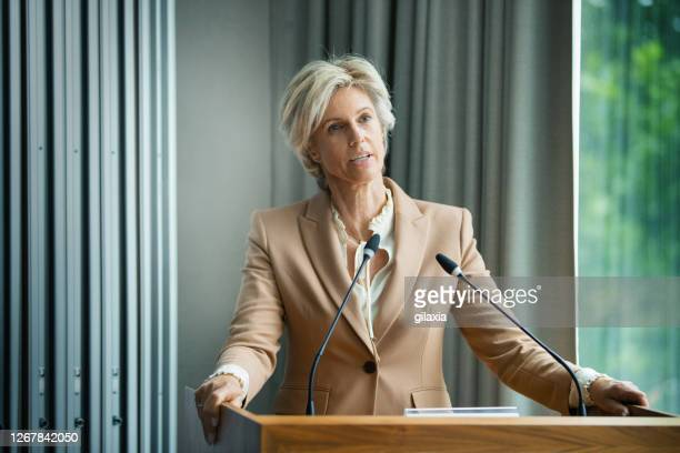 management staff speaking at a company meeting - politician stock pictures, royalty-free photos & images