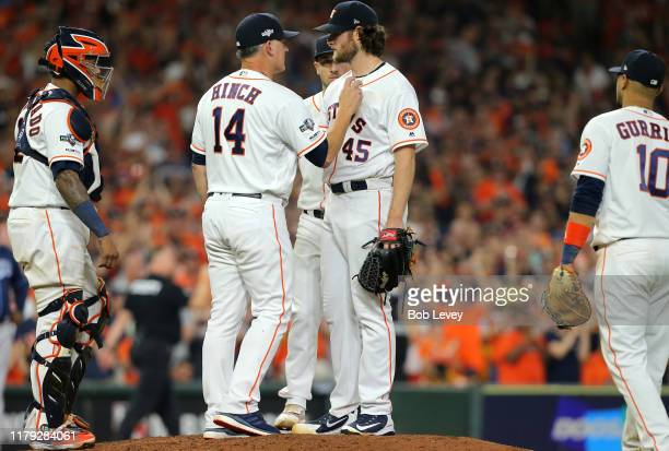 Manager A J Hinch of the Houston Astros takes out starting pitcher Gerrit Cole during the eighth inning of Game 2 of the ALDS against the Tampa Bay...