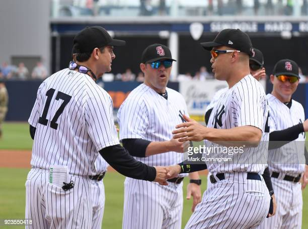 Manager Aaron Boone and Giancarlo Stanton of the New York Yankees shake hands during player introductions prior to the Spring Training game against...