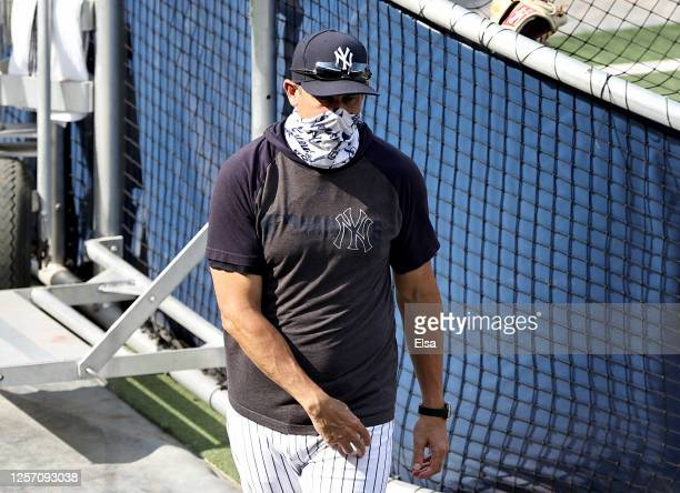 Manager Aaron Boone of teh New York Yankees walks on the field before the game against the New York Mets during Summer Camp play at Yankee Stadium on...