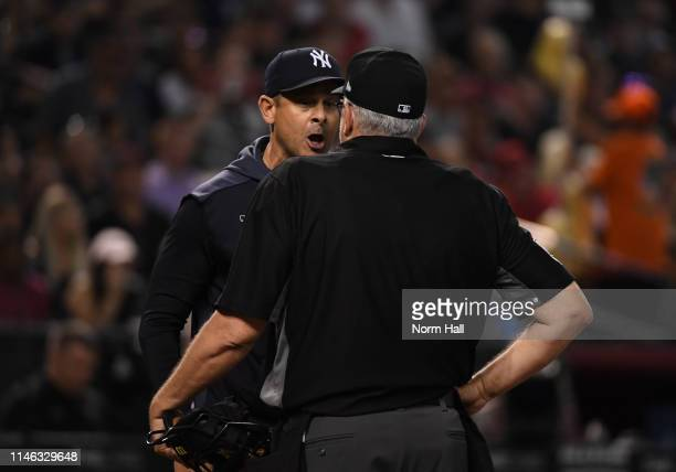 Manager Aaron Boone of the New York Yankees argues with home plate umpire Paul Emmel after being ejected during the seventh inning of a game against...