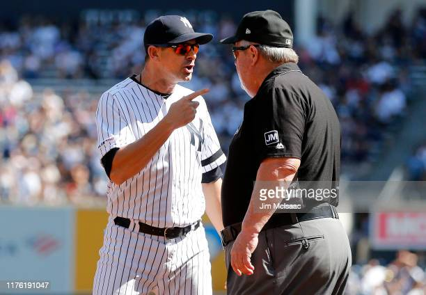 Manager Aaron Boone of the New York Yankees argues with umpire crew chief Joe West after he was ejected from a game against the Toronto Blue Jays...