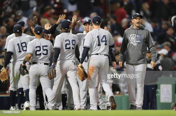 Manager Aaron Boone of the New York Yankees celebrates with his players after their 62 win in Game Two of the American League Division Series against...