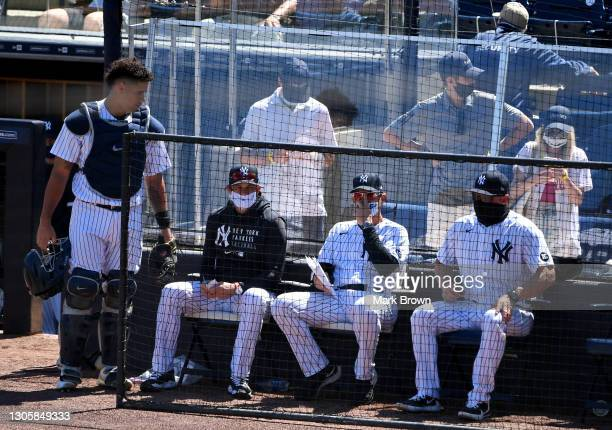 Manager Aaron Boone of the New York Yankees coaches against the Philadelphia Phillies in a spring training game at George M. Steinbrenner Field on...