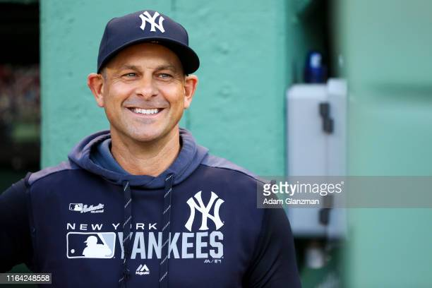 Manager Aaron Boone of the New York Yankees looks on before a game against the Boston Red Sox at Fenway Park on July 25, 2019 in Boston,...