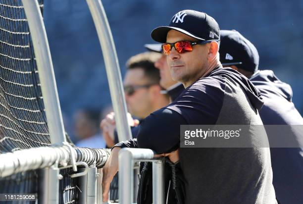Manager Aaron Boone of the New York Yankees looks on during batting practice prior to game three of the American League Championship Series against...