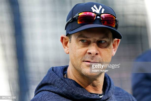Manager Aaron Boone of the New York Yankees looks on during batting practice prior to taking on the Baltimore Orioles at Yankee Stadium on April 6...