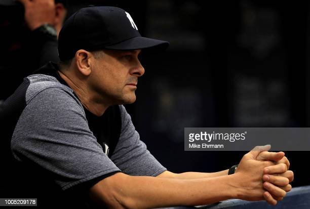 Manager Aaron Boone of the New York Yankees looks on in the first inning during a game against the Tampa Bay Rays at Tropicana Field on July 25 2018...
