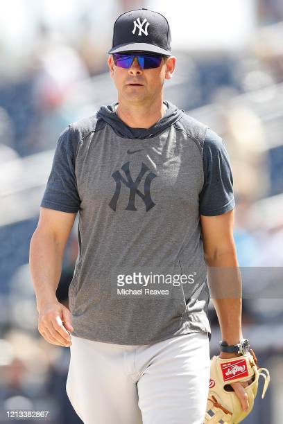 Manager Aaron Boone of the New York Yankees looks on prior to a Grapefruit League spring training game against the Washington Nationals at FITTEAM...