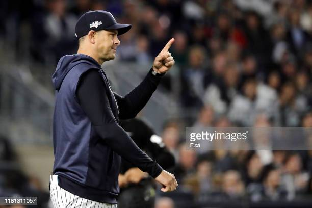 Manager Aaron Boone of the New York Yankees makes a pitching change during the seventh inning against the Houston Astros in game three of the...