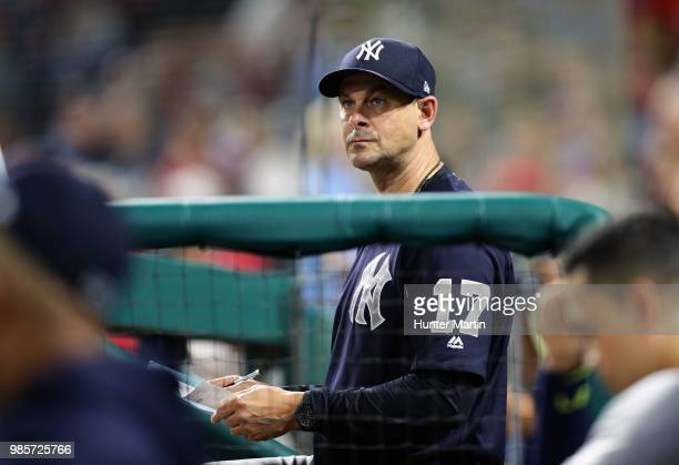 Manager Aaron Boone of the New York Yankees stands in the dugout in the eighth inning during a game against the Philadelphia Phillies at Citizens...