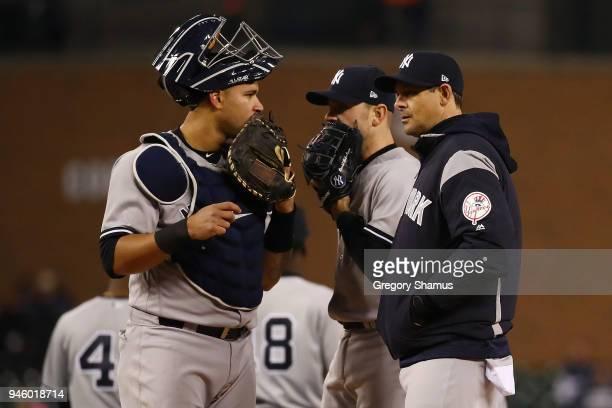 Manager Aaron Boone of the New York Yankees talks with Gary Sanchez during the seventh inning while playing the Detroit Tigers at Comerica Park on...