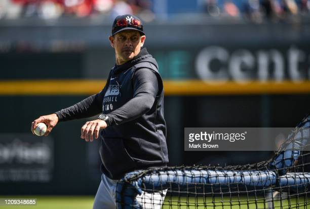 Manager Aaron Boone of the New York Yankees throws a pitch during batting practice before the spring training game against the Atlanta Braves at Cool...