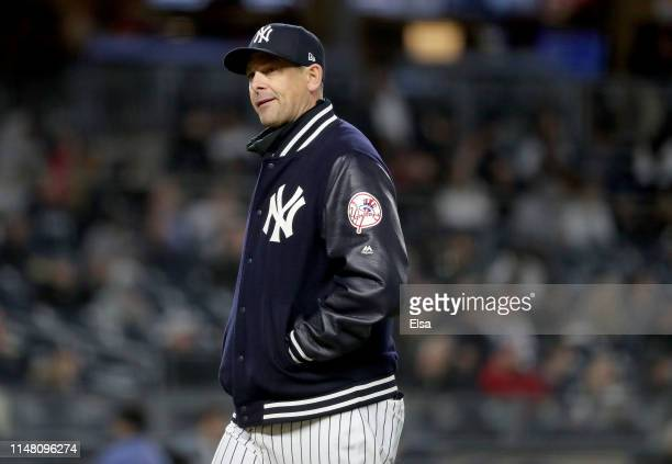 Manager Aaron Boone of the New York Yankees walks back to the dugout in the sixth inning against the Seattle Mariners at Yankee Stadium on May 09,...