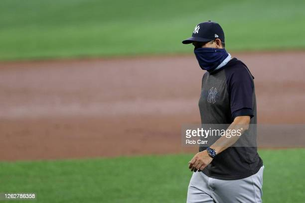 Manager Aaron Boone of the New York Yankees walks off the mound during a pitching change against the Baltimore Orioles at Oriole Park at Camden Yards...