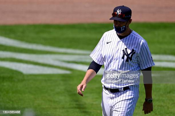 Manager Aaron Boone of the New York Yankees walks on the field prior to the game against the Toronto Blue Jays during a spring training game at...