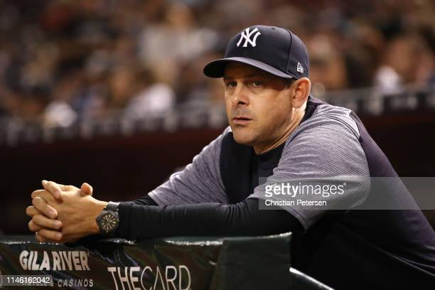 Manager Aaron Boone of the New York Yankees watches from the dugout during the sixth inning of the MLB game against the Arizona Diamondbacks at Chase...