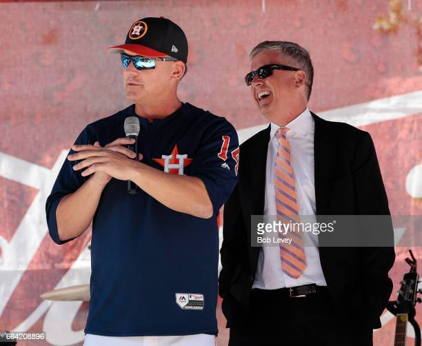 Manager AJ Hinch left and Houston Astros general manager Jeff Luhnow talk to fans during a Fan Fest before playing the Seattle Mariners on opening...