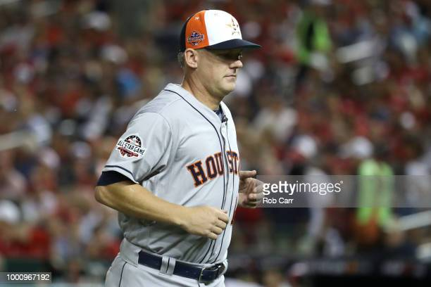 Manager AJ Hinch of the Houston Astros and American League runs off the field after making a pitching change in the fourth inning against the...