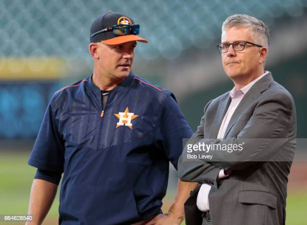 Manager AJ Hinch of the Houston Astros and general manager Jeff Luhnow talk during batting practice at Minute Maid Park on April 4 2017 in Houston...