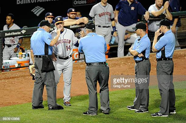 Manager AJ Hinch of the Houston Astros argues a call with the umpire crew in the sixth inning against the Baltimore Orioles at Oriole Park at Camden...