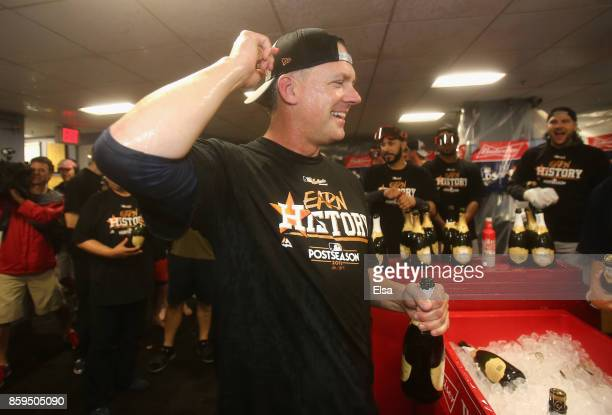 Manager AJ Hinch of the Houston Astros celebrates in the clubhouse after defeating the Boston Red Sox 54 in game four of the American League Division...