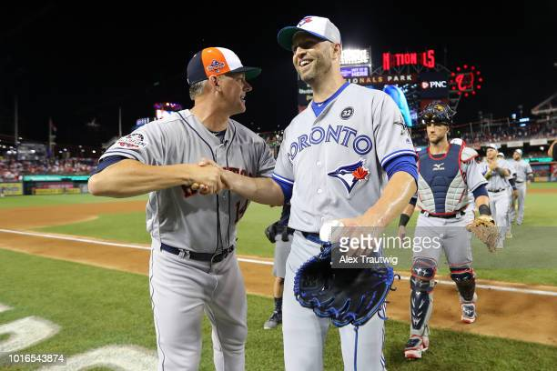 Manager AJ Hinch of the Houston Astros celebrates with JA Happ of the Toronto Blue Jays after defeating the National League 86 in the 89th MLB...