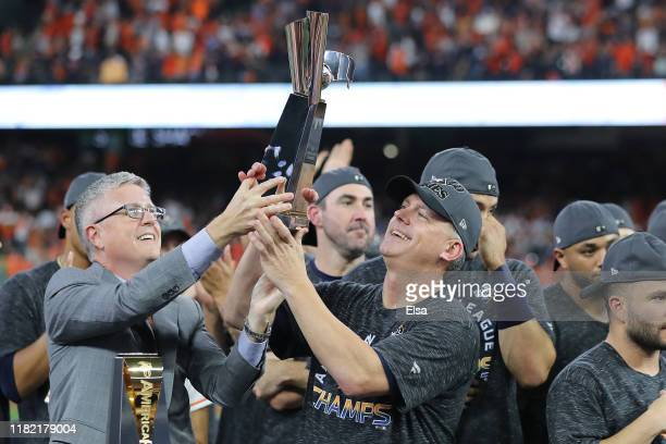 Manager AJ Hinch of the Houston Astros celebrates with the trophy following his teams 64 win against the New York Yankees in game six of the American...