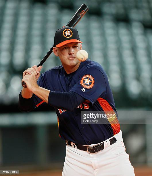 Manager AJ Hinch of the Houston Astros hits ground balls during batting practice before a game between the Kansas City Royals and Houston Astros at...