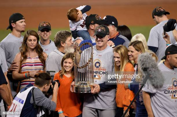 Manager AJ Hinch of the Houston Astros holds the Commissioner's Trophy after defeating the Los Angeles Dodgers 51 in game seven to win the 2017 World...