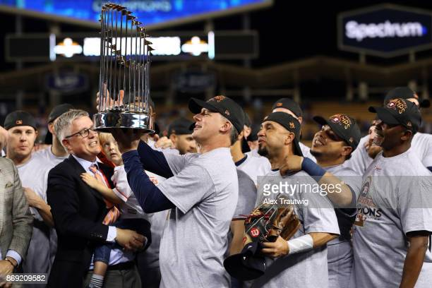 Manager A.J. Hinch of the Houston Astros lifts the Commissioner's Trophy after the Astros defeated the Los Angeles Dodgers in Game 7 of the 2017...