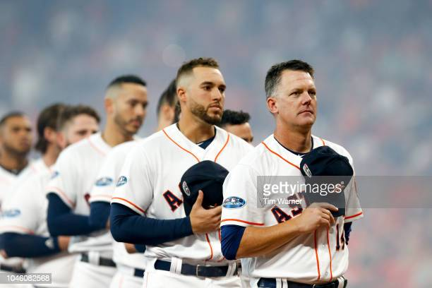 Manager AJ Hinch of the Houston Astros looks on during the playing of the national anthem prior to Game One of the American League Division Series...