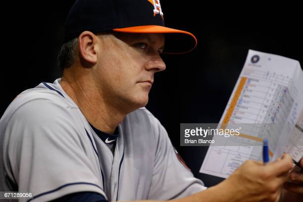 Manager AJ Hinch of the Houston Astros looks on from the dugout during the second inning of a game against the Tampa Bay Rays on April 21 2017 at...