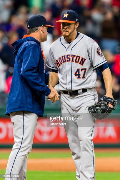 Manager AJ Hinch of the Houston Astros removes relief pitcher Chris Devenski during the ninth inning against the Cleveland Indians at Progressive...