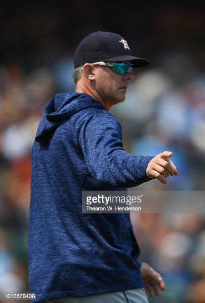Manager AJ Hinch of the Houston Astros signals the bullpen to make a pitching change against the San Francisco Giants in the bottom of the seventh...