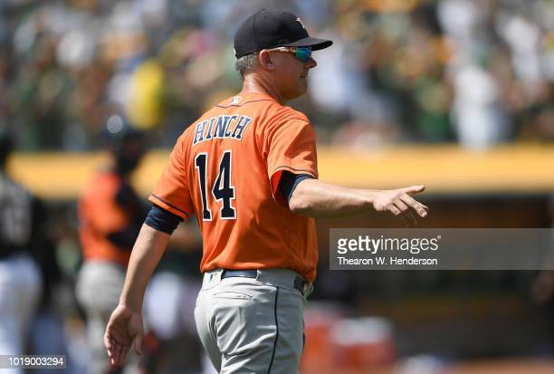Manager AJ Hinch of the Houston Astros signals the bullpen to make a pitching change against the Oakland Athletics in the bottom of the six inning at...