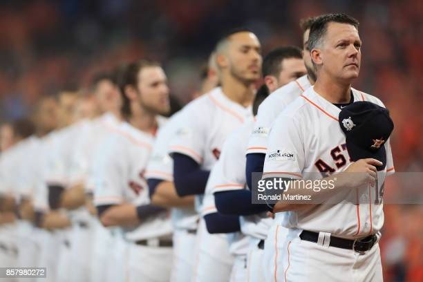 Manager AJ Hinch of the Houston Astros stands during a moment of silence honoring the victims of the recent Las Vegas shooting before game one of the...