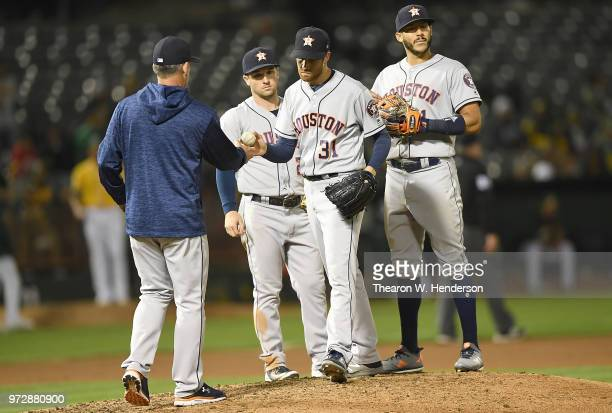 Manager AJ Hinch of the Houston Astros takes the ball from pitcher Collin McHugh taking McHugh out of the game against the Oakland Athletics in the...