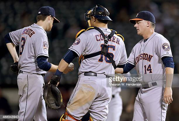 Manager AJ Hinch of the Houston Astros takes the ball from starting pitcher Collin McHugh taking him out of the game against the Oakland Athletics in...