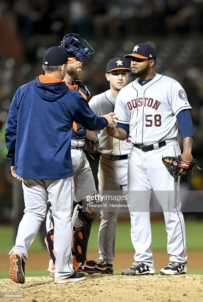 Manager A.J. Hinch #14 of the Houston Astros takes the ball from starting pitcher Francis Martes #58 taking Martes out of the game against the Oakland Athletics in the bottom of the six inning at Oakland Alameda Coliseum on June 20, 2017 in Oakland, California.