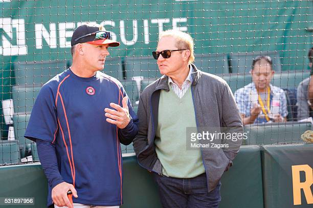 Manager A.J. Hinch of the Houston Astros talks with Agent Scott Boras on the field prior to the game against the Oakland Athletics at the Oakland...