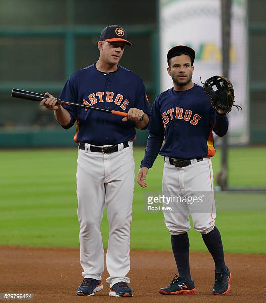 Manager AJ Hinch of the Houston Astros talks with Jose Altuve during batting practice before playing the Cleveland Indians at Minute Maid Parkon May...