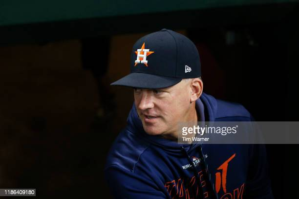 Manager AJ Hinch of the Houston Astros walks into the dugout before Game Seven of the 2019 World Series against the Washington Nationals at Minute...