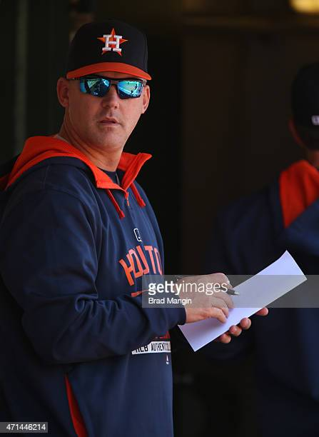 Manager AJ Hinch of the Houston Astros writes on his lineup card in the dugout during the game against the Oakland Athletics at Oco Coliseum on...