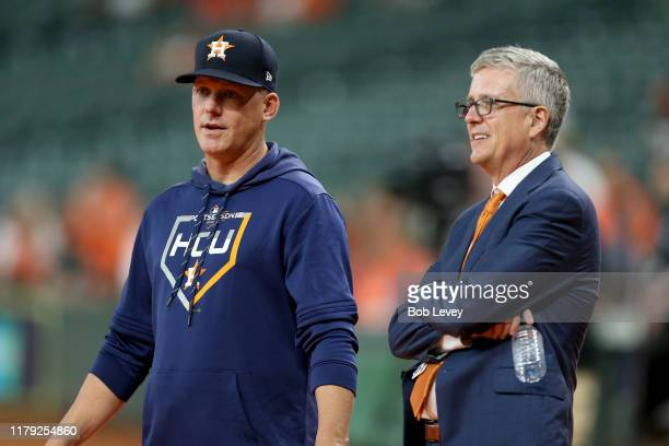 Manager AJ Hinch talks with Jeff Luhnow General Manager of the Houston Astros prior to game two of the American League Division Series against the...