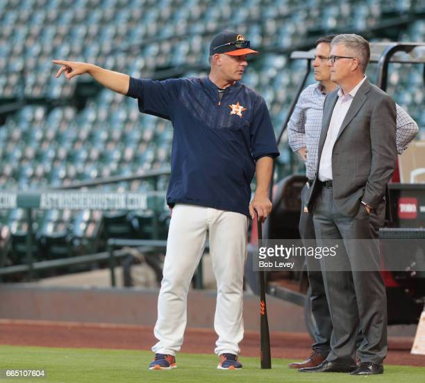 Manager AJ Hitch of the Houston Astros and general manager Jeff Luhnow talk during batting practice at Minute Maid Park on April 4 2017 in Houston...