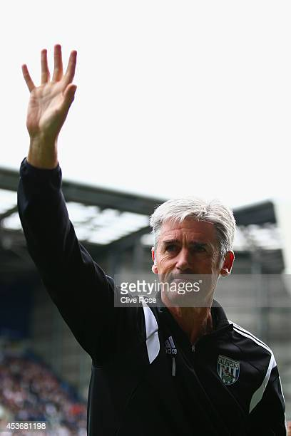 Manager Alan Irvine of West Brom waves to the fans during the Barclays Premier League match between West Bromwich Albion and Sunderland at The...
