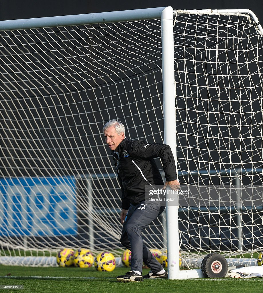 Manager Alan Pardew holds on to the goal posts during a training session at The Newcastle United Training Centre on November 20, 2014, in Newcastle upon Tyne, England.