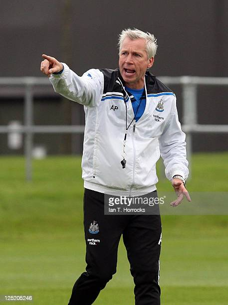 Manager Alan Pardew issues instructions during a Newcastle United training session at the Little Benton training ground on September 16, 2011 in...