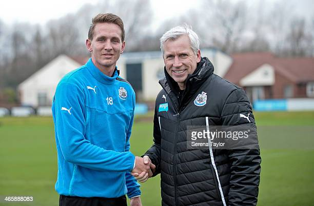 Manager Alan Pardew shakes hands with New Signing Luuk de Jong after a training session at The Newcastle United Training Centre on January 30 in...